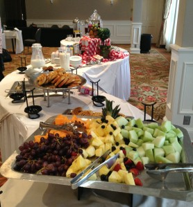 Morning breakfast buffet including fresh cut fruit, danish/pastries, cereal, and yogurt.