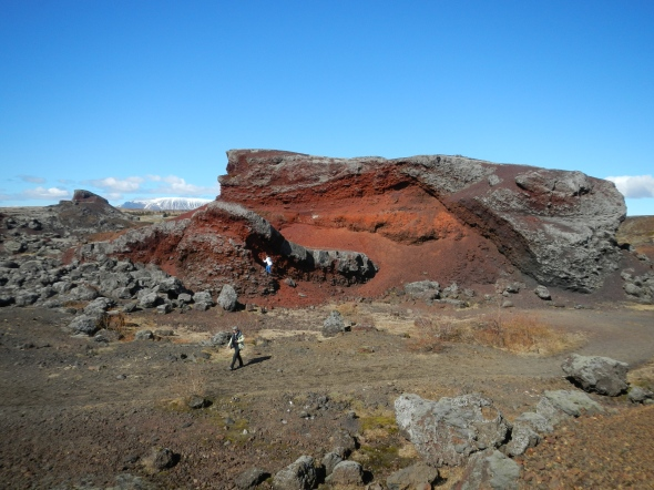 "The Rauðhólar (""Red Hills"") in the Elliðaárhraun lava fields.  Note the humans for scale!"