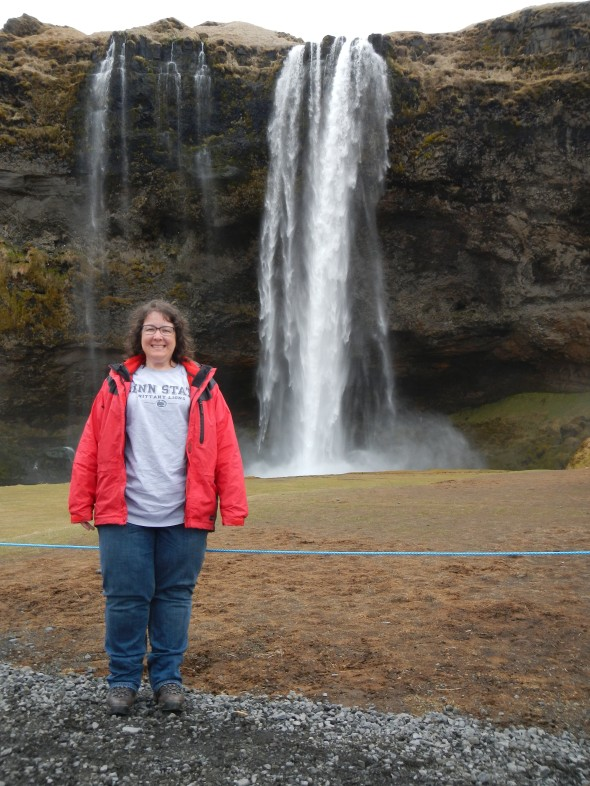 That's me, right before I walked behind this Icelandic waterfall named Seljalandsfoss.