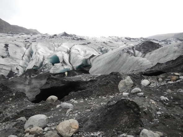 Looking at the glacier snout known as Solheimajokrull.  Can you find the human for scale?