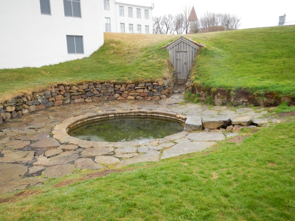 The scene of the crime and the end of Snorri.  The wooden doorway leads to an underground tunnel that Snorri had built so he could walk from his house to the hot spring indoors, spending as little time outdoors in the cold as possible.