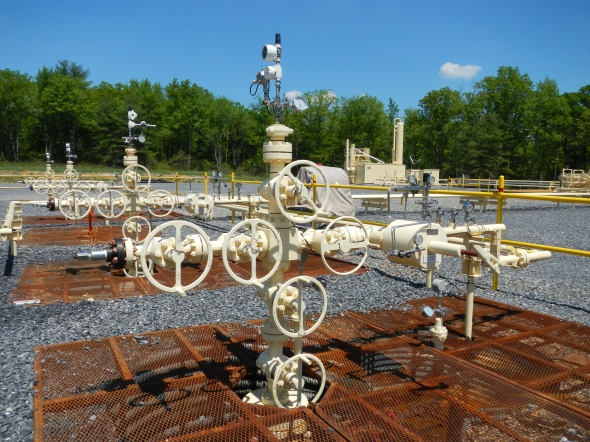 A closeup of the five wellheads that cap the drilled boreholes.