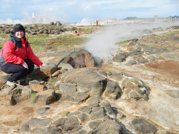That's me, right next to one of the vents on this hydrothermal field.  Kids, do not try this at home!  Not only could the rocks be too hot to touch and burn your hand, the rocks you walk on could melt the soles of your hiking boots.