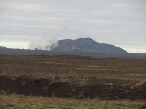 Not the best photo (but it was taken out of the window of a moving bus). My first glimpse of basaltic fields as far as the eye can see, and perhaps a geothermal power plant in the distance!