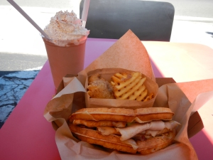 My lunch at Bruxie, a turkey club on a waffle, with waffle fries and a Belgium chocolate milkshake.