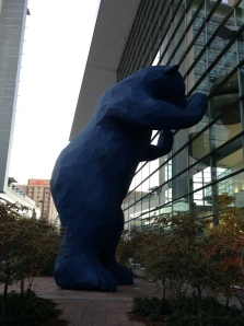 Part of Denver's public art, the big blue bear peers through the glass in to the Colorado Convention Center.