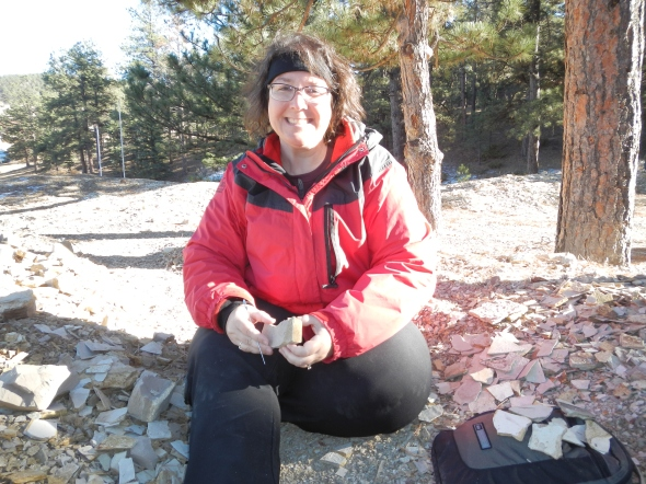Sitting and splitting paper shale, looking for fossils, at Florissant Fossil Quarry