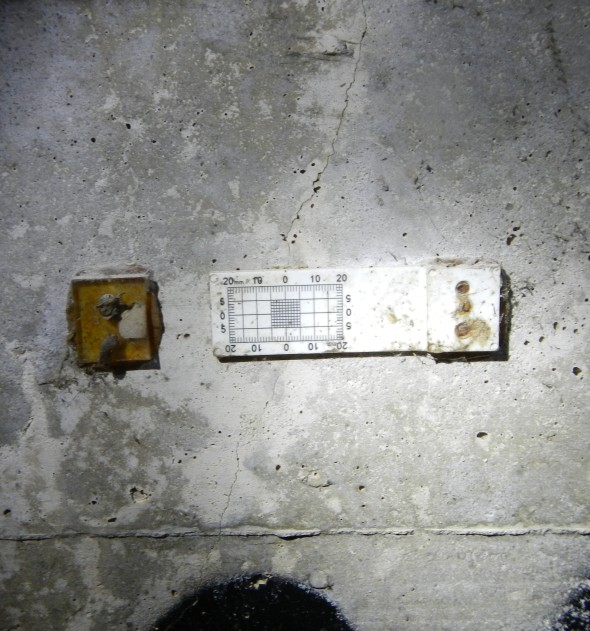 This scale is placed along cracks in the tunnel so that measurements can be taken to track further growth of the crack.