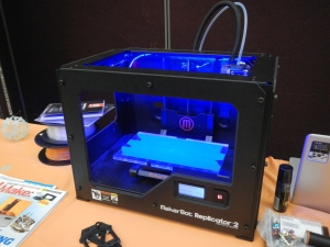 Karyn's 3D printer, printing a hand at the conference