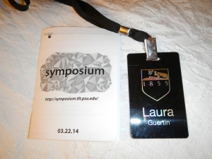 "Conference program and name badge.  I really appreciate how small and ""green"" the program is - with the use of sched.org, every conference attendees has the entire program in their hands!"