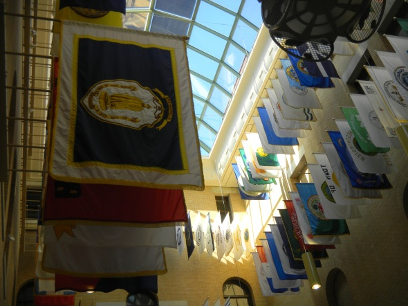 The Great Hall, which is a new addition to the State House, complete din 1990.  Hanging in this room are the flags of each city in the state of Massachusetts.  The one in front on the left is of Springfield - the city where I was born!