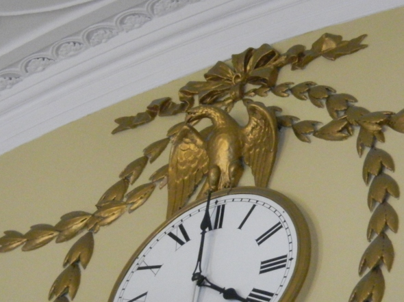 A clock with an interesting story!  At the time this clock was designed, the nation had not yet settled on a national bird.  Since the leading candidates were the turkey and the bald eagle, the artist designed a creature that had features of both animals - so what you see here is not a real animal but parts of two different ones!