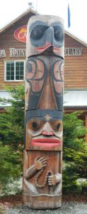 This pole is called Raven and the Tide Woman - definitely a different way to explain the tidal changes! The story is at: http://www.alaskarainforest.com/pages/TotemPark9.htm