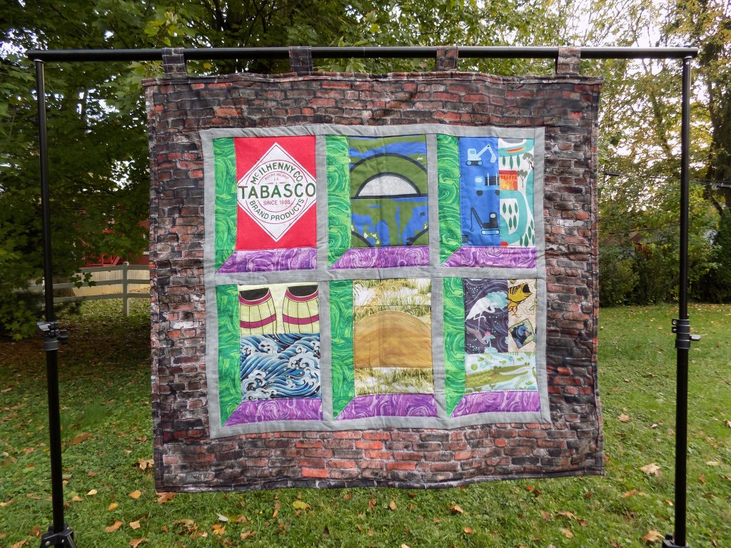 Photo of TABASCO quilt hanging outdoors