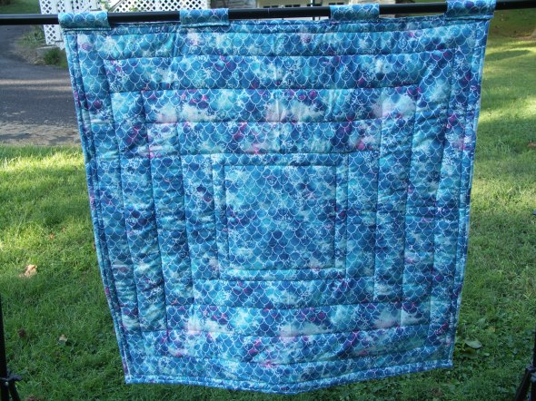 mermaid fabric on the back of a quilt