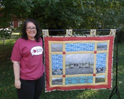 Dr. G posed with levee quilt