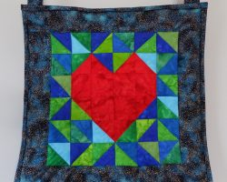 Image of hanging quilt I HeART Earth Science